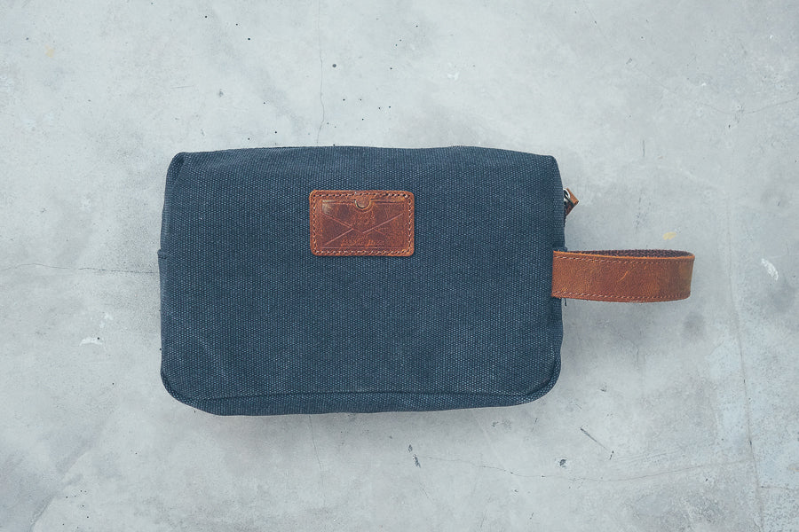 The back view of toiletry bag is plain navy blue material