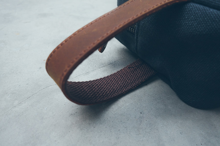 Leather handle for toiletry bag