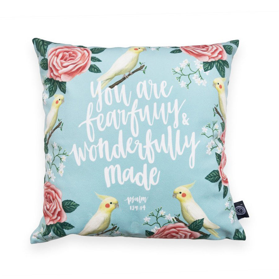 Cushion cover 'You are fearfully and wonderfully made' on blue background and details of a garden and songbirds