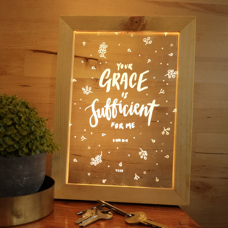 "Night light with wooden frame, acrylic insert, LED energy saving warm white light. 17cmx23cm measurements. Holly details with ""Your grace is sufficient for me"" typography."