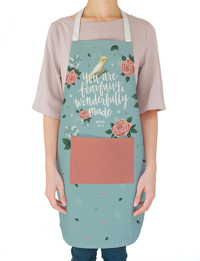 Light blue apron with roses and birds details. 'You are fearfully and wonderfully made'. Gift it to your favourite home chef! Great mother's Day gift too