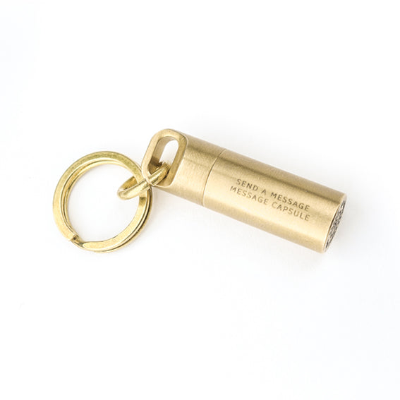 Mini capsule brass key chain comes with message paper for you to write hidden messages and store in the waterproof capsule.
