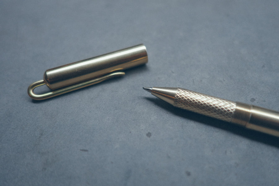 Close up of tip of brass pen