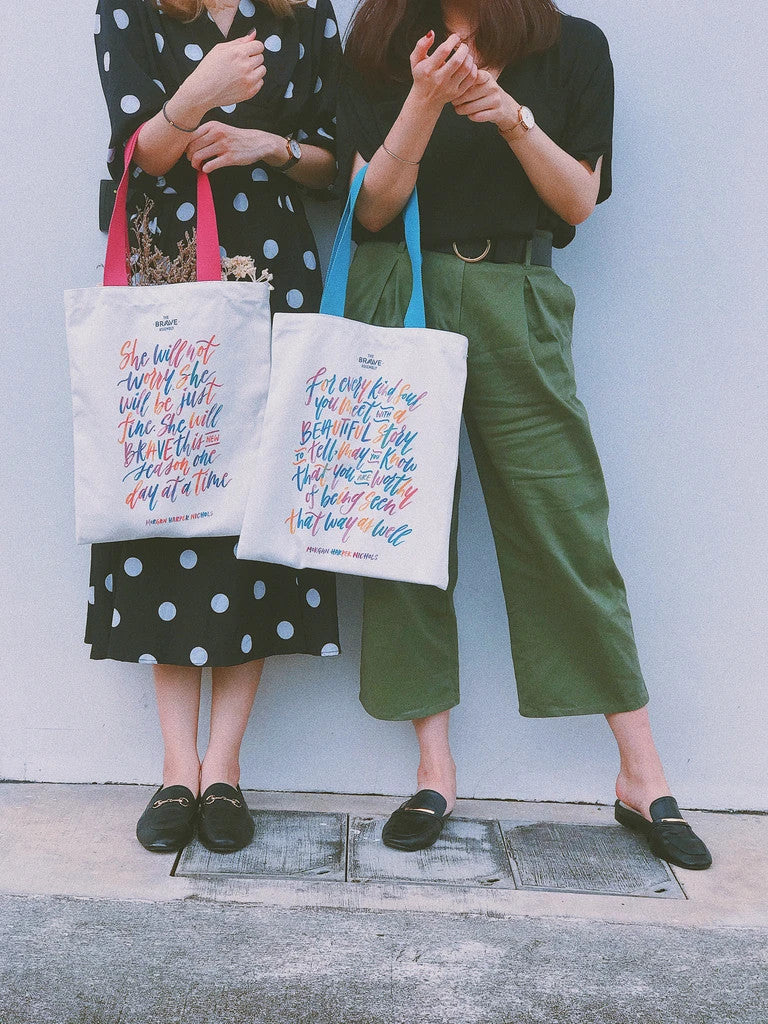 Two girl carrying encourage tote bag