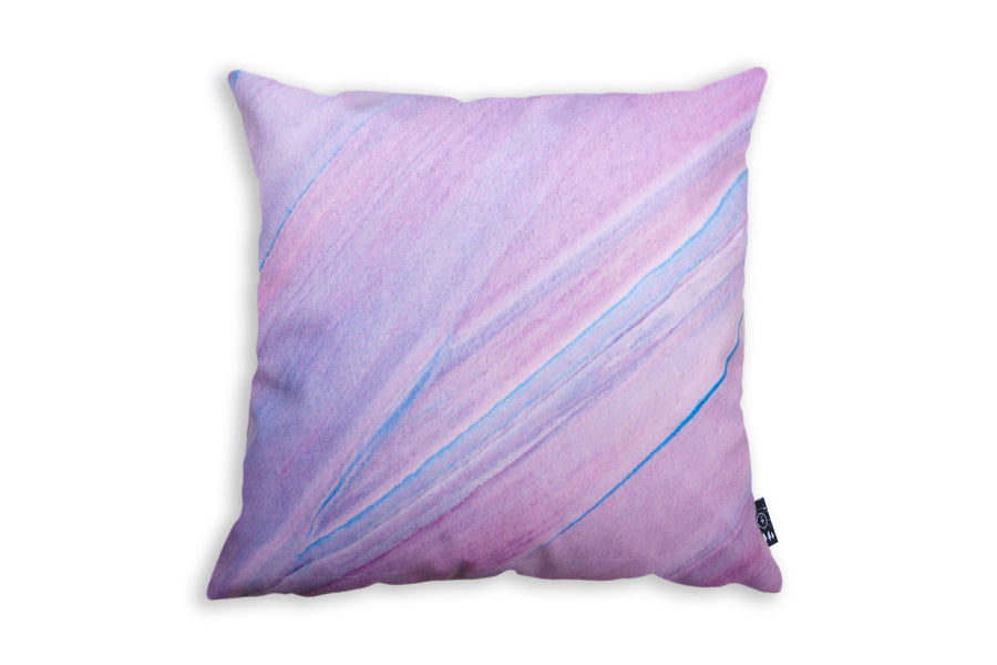 The back of the cushion cover is milky way pink with hints of blue.
