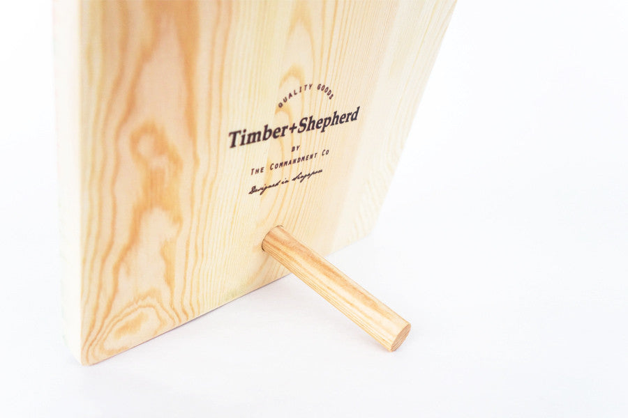 Back view of standing Wooden board with the Timber+Shepherd and Commandment Co collaboration logo