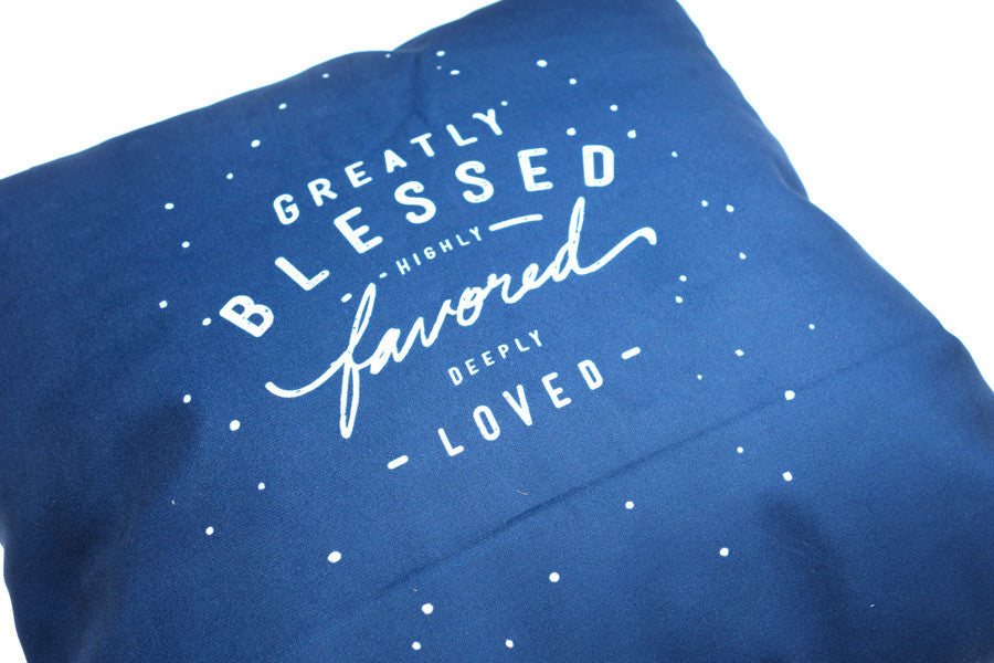 the back design features navy blue background with white verse font