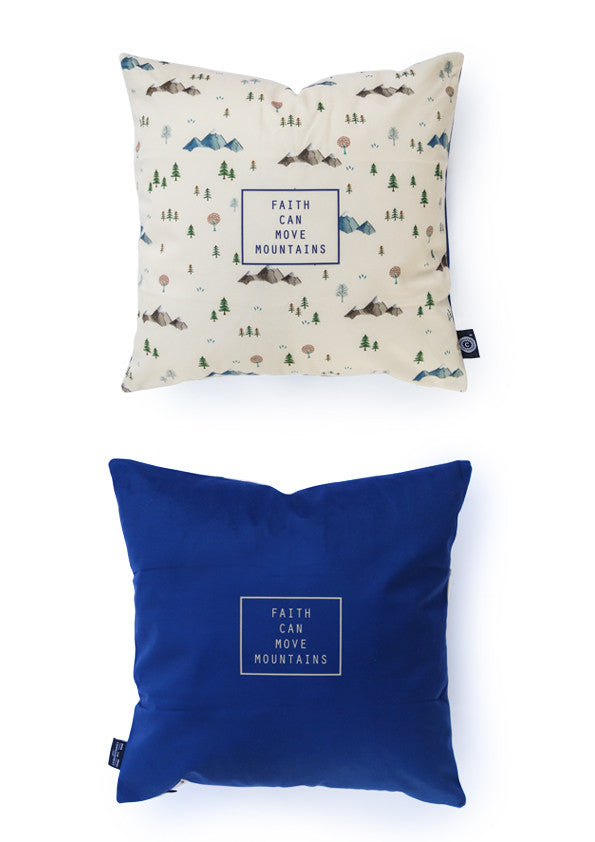 The back of the cushion cover features cobalt blue background and 'faith can move mountains' in the centre