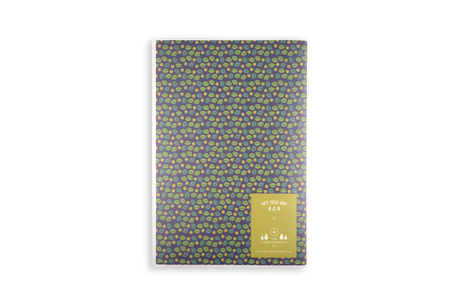 Notebook features small leaves designs on navy blue background