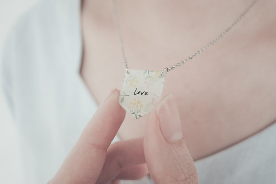 And the greatest of all these is love. Inspirational love messages for an acrylic banner necklace