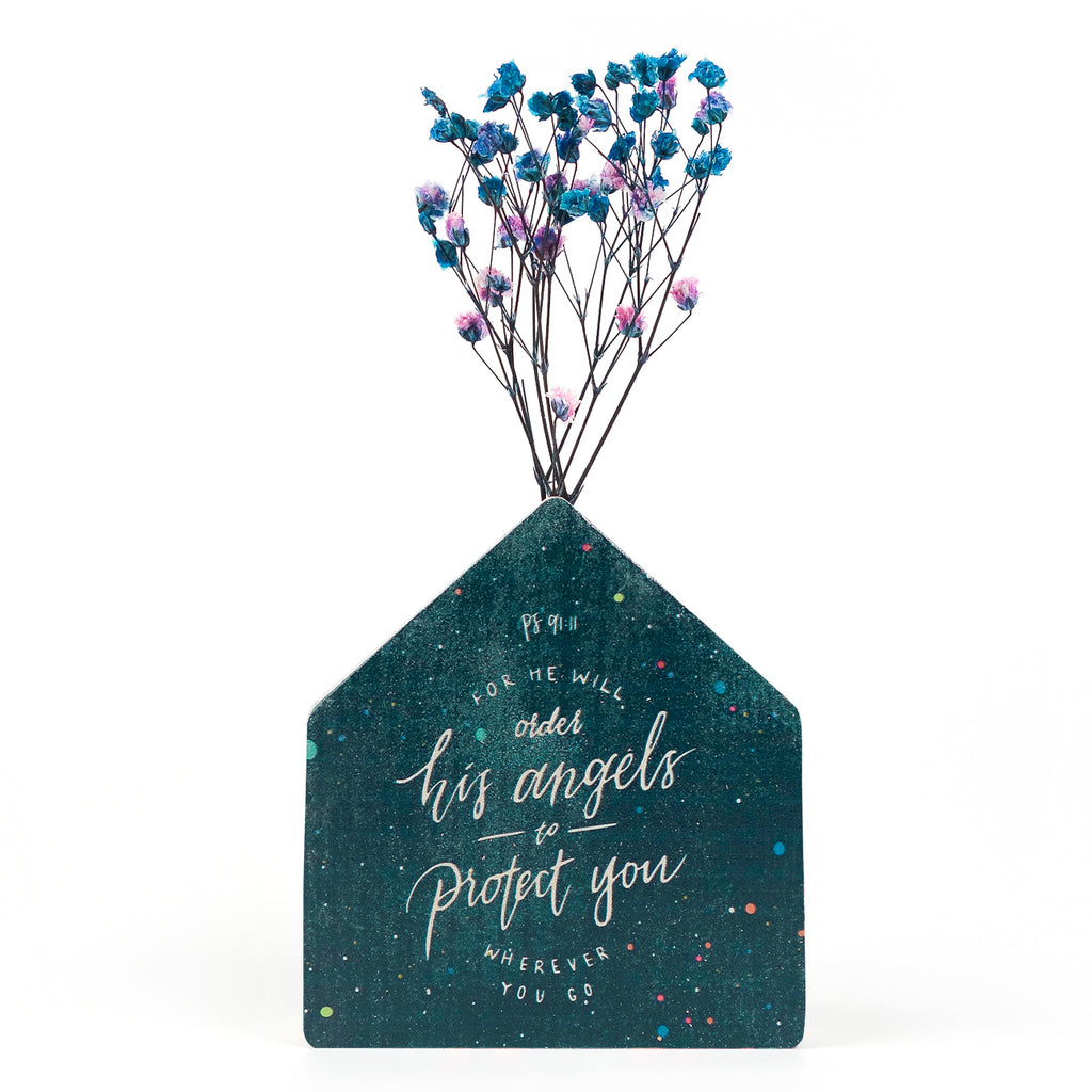 Wooden vase in the shape of a dark blue house decorated with dried blue and pink baby's breath. Featuring Ps 91:11