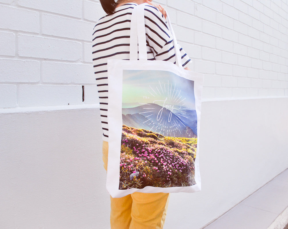 Tote bag made of 100% organic cotton from India. Features 'Joy'.