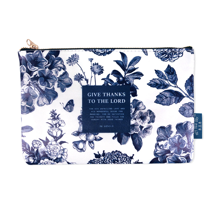 Multipurpose PU Leather pouch in off white with mountains designs on it. Features bible verse ' give thanks to the Lord' in blue lettering and is great Christian gift idea. The pouch has inner lining, gold zip. Dimensions: 21cm (W) x 14cm (H)