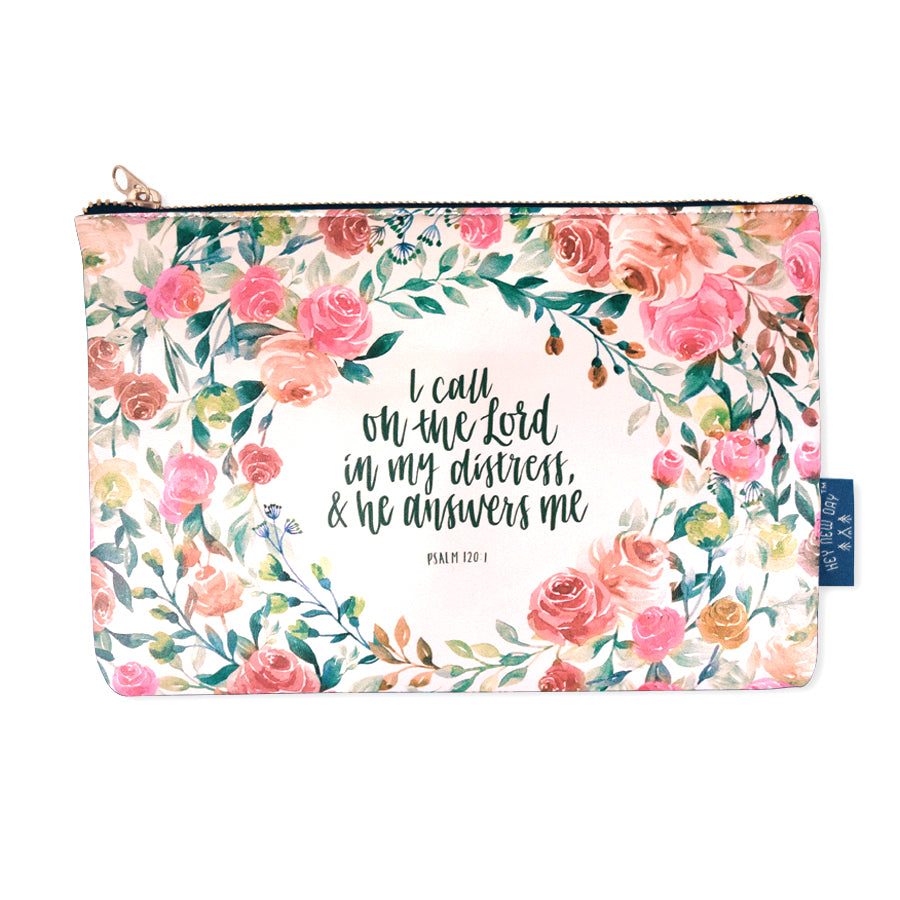 Multipurpose PU Leather pouch in off white with roses designs on it. Features bible verse Psalm 120:1 in the inner lining and is great Christian gift idea. The pouch has polyester inner lining, gold zip. Dimensions: 21cm (W) x 14cm (H)