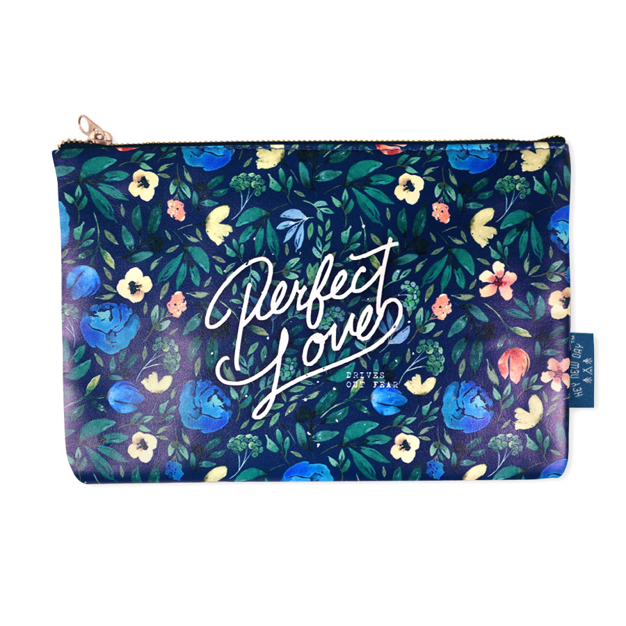 Multipurpose PU Leather pouch in blue with floral designs on it. Features bible verse 'Perfect Love ' in white lettering and is great Christian gift idea. The pouch has inner lining, gold zip. Dimensions: 21cm (W) x 14cm (H)