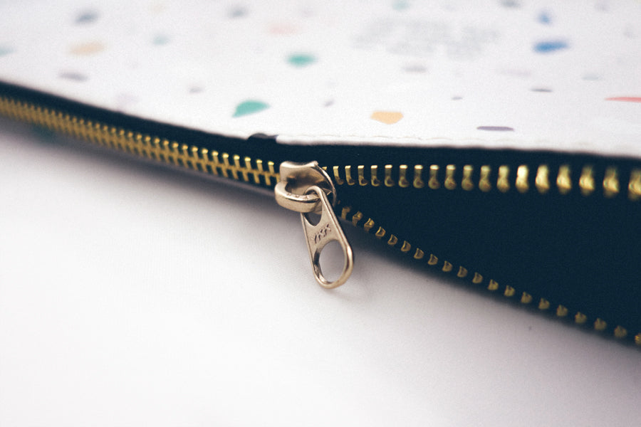 Golden zip detailing of pouch. Pouch is multipurpose and can be used to store money, make up, stationeries, small documents!
