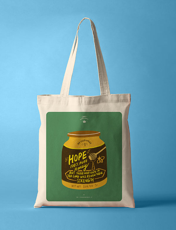 Tote bag made of 100% organic cotton from India. Features a honey jar and HOPE design.