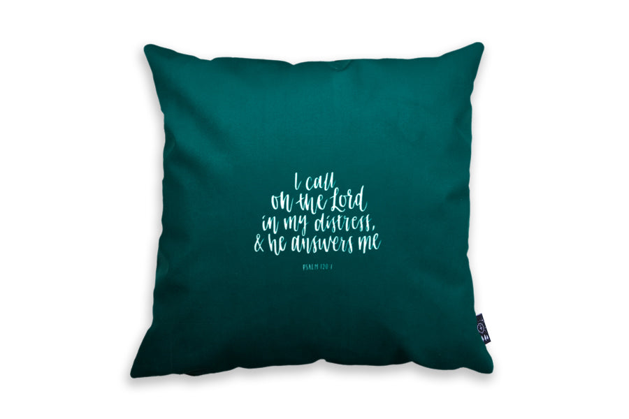 Back of dark green cushion cover with white font.