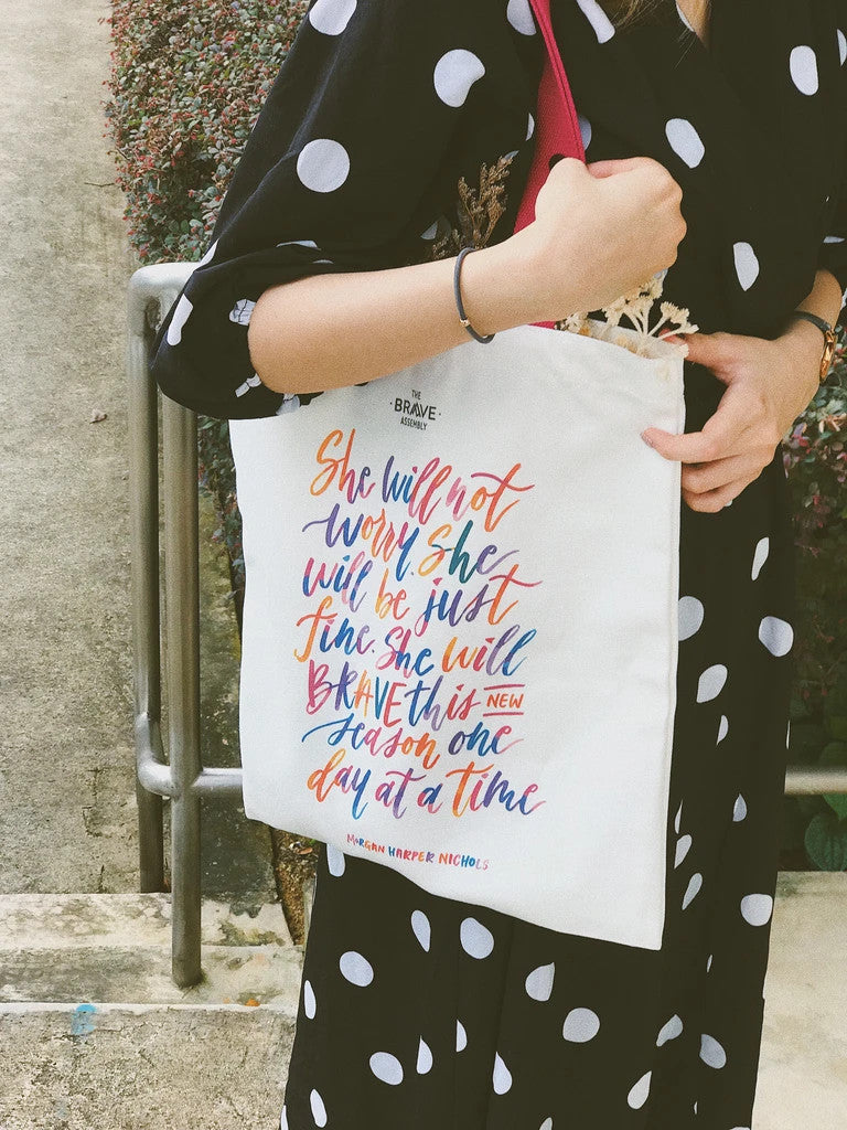 Versatile tote bag made of cotton. with pink straps and colourful typography. Perfect as gifts for women everywhere.