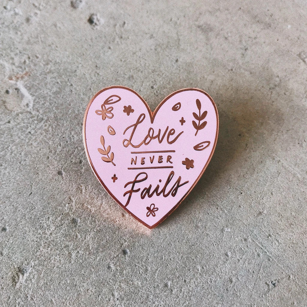 Love never fails enamel pin