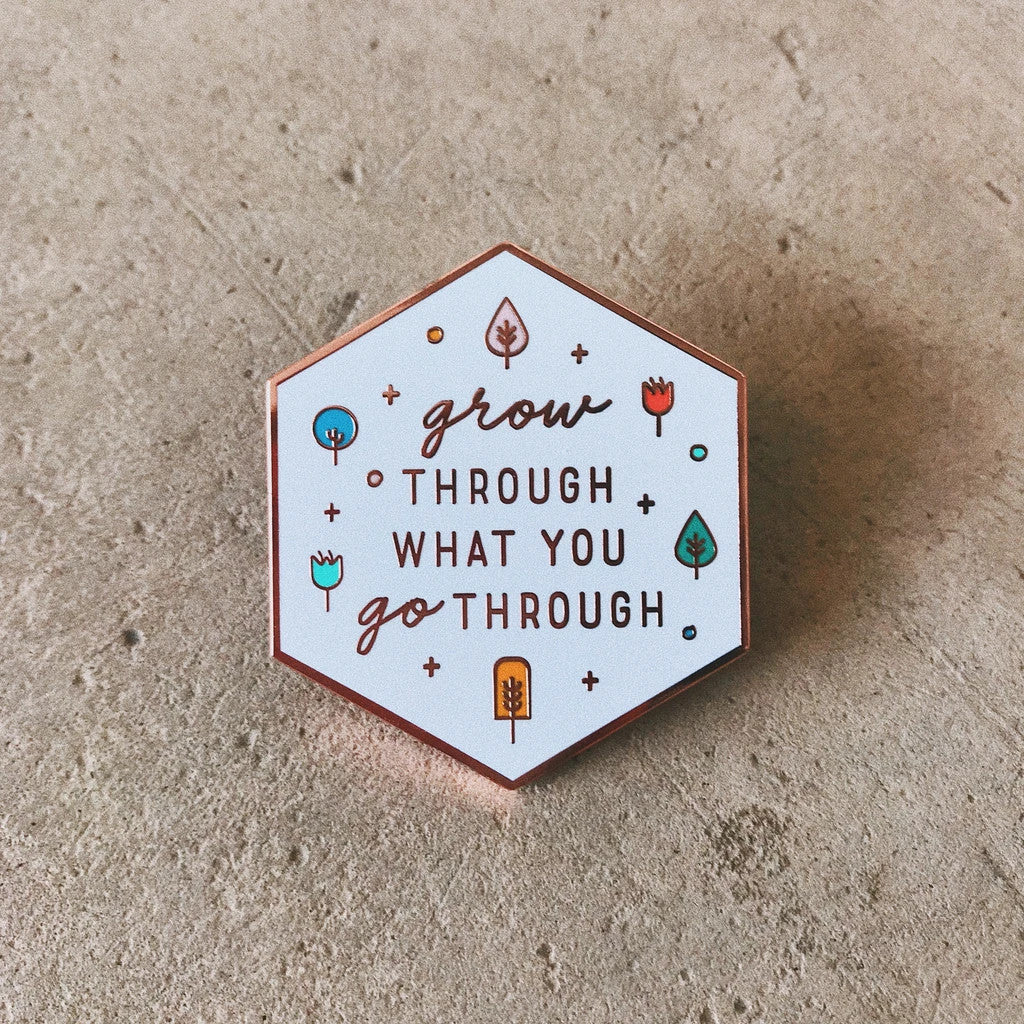 Grow through what you grow through enamel pin. Motivational messages on a cute pin.