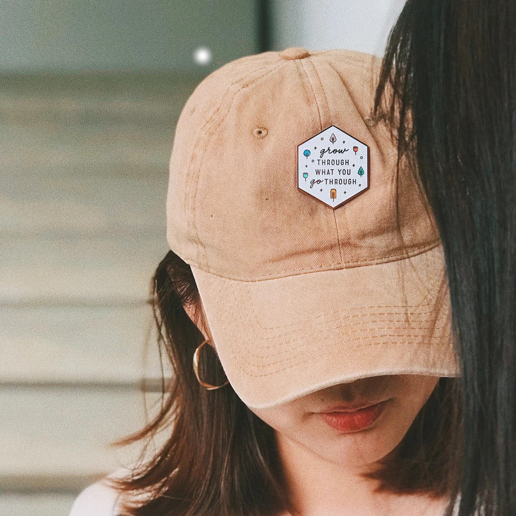 Pin can be attached to caps to make a cute fashion statement
