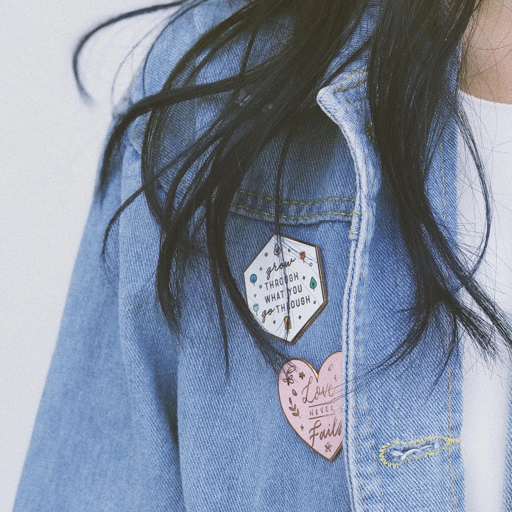 enamel pins on denim jacket makes a cute outfit statement