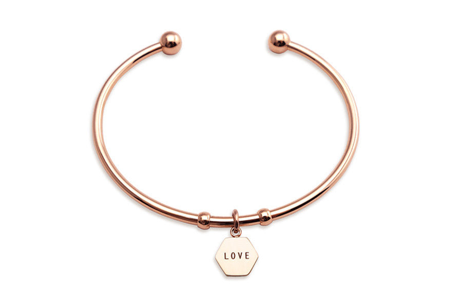 adjustable bangle with hexagon shaped pendant 'love'.