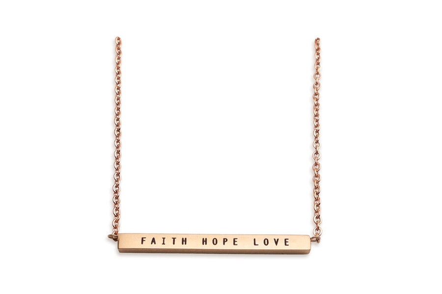Rose gold bar necklace. IP plated stainless steel. Measurements: Pendant Length 3.2 inches, Width 0.15 inches, Height 0.2 inches, Chain Length 17.5 inches. Engraving : Faith hope love