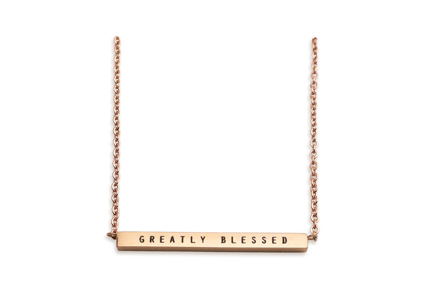 Rose gold bar necklace. IP plated stainless steel. Measurements: Pendant Length 3.2 inches, Width 0.15 inches, Height 0.2 inches, Chain Length 17.5 inches. Engraving : Greatly blessed