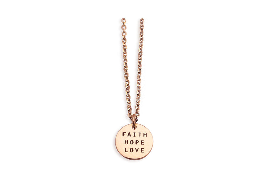 Stainless steel, rose gold plated. Engravings of encouragement words 'faith hope love'. Measurements: Pendant Length 3.2 inches, Width 0.15 inches, Height 0.2 inches, Chain Length 17.5 inches
