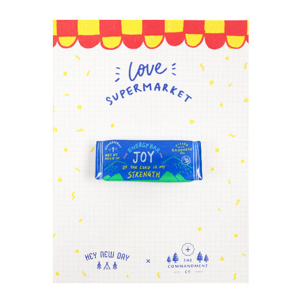 "Joy energy bar acrylic pin carrying inspirational message ""the joy of the Lord is my strength""."