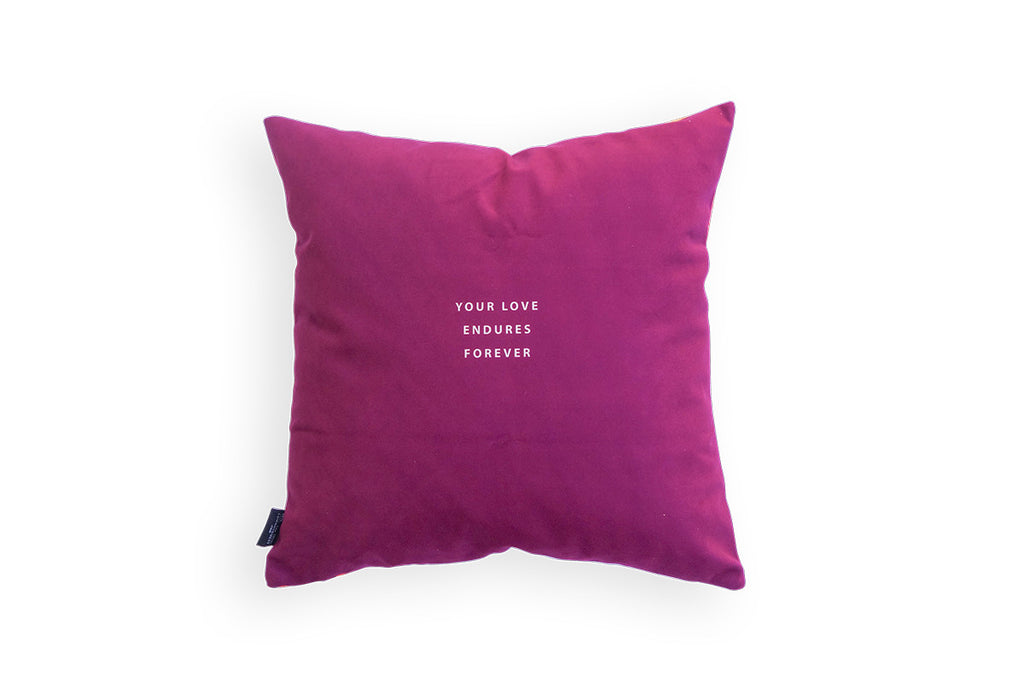 Maroon background with small white font 'your love endures forever' at the back of the pillow cover