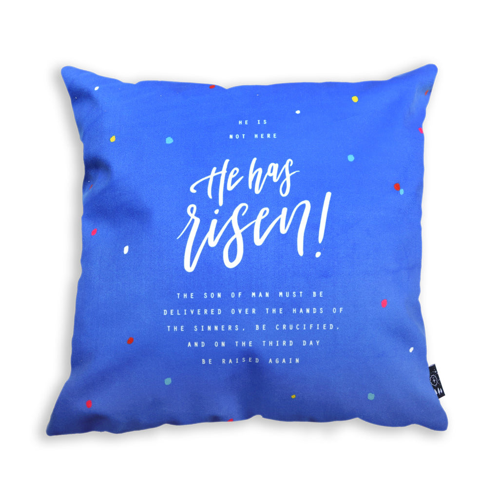 Blue cushion cover with white font typography on cushion cover