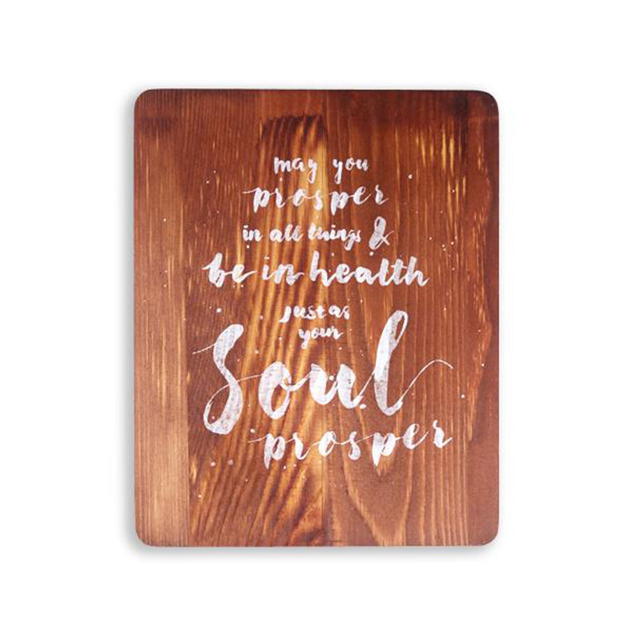 motivational bible verse 'May you prosper in all things' on wood background with white font details digitally printed on 16cmx20cm quality pine wood.