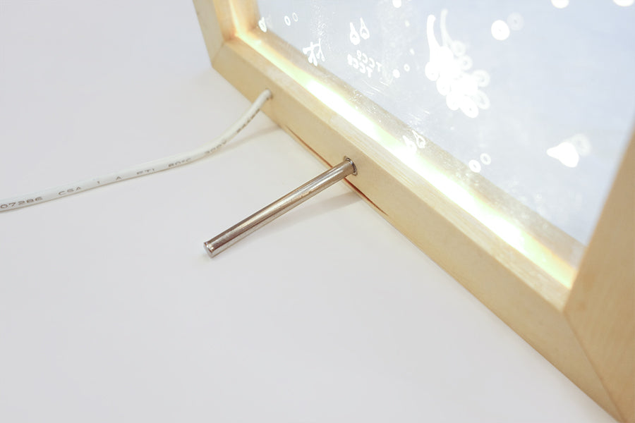 Metal rod back stand for supporting the night light.