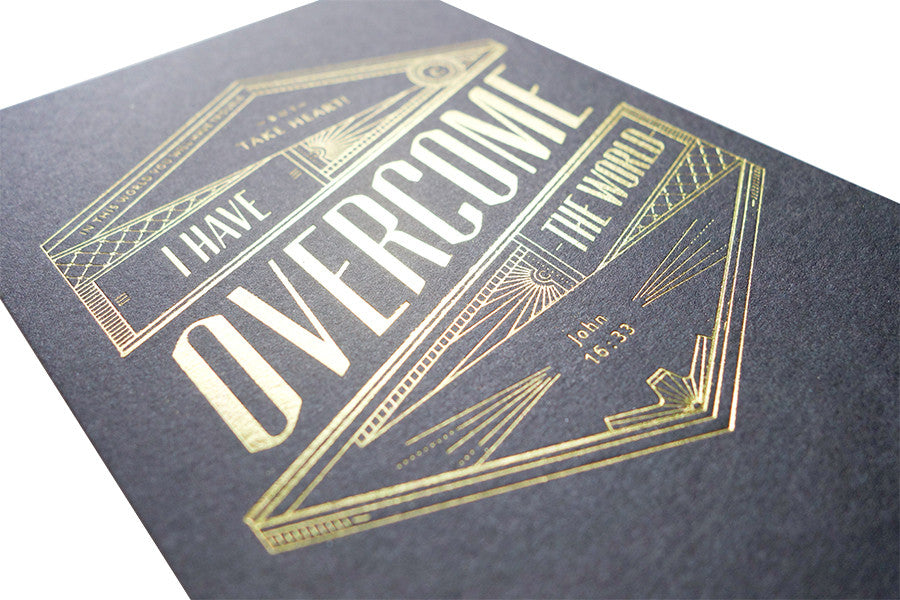 The background of the card is matte black and allows the golden font to stand out more.