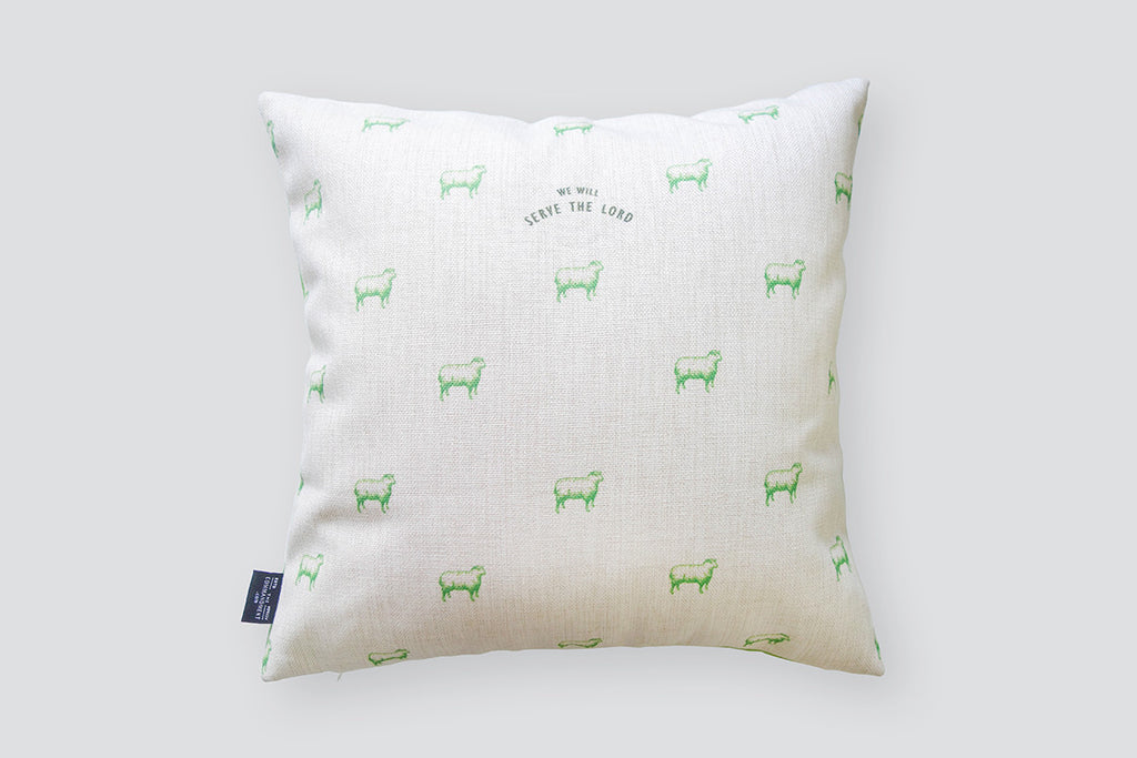 Sheep designs in neon green at the back of the cushion cover.