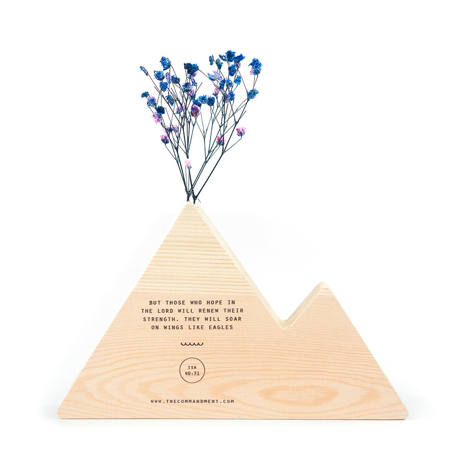 Wooden mountain vase adds a splash of inspiration to your homes. Creative interior design of Christian home.