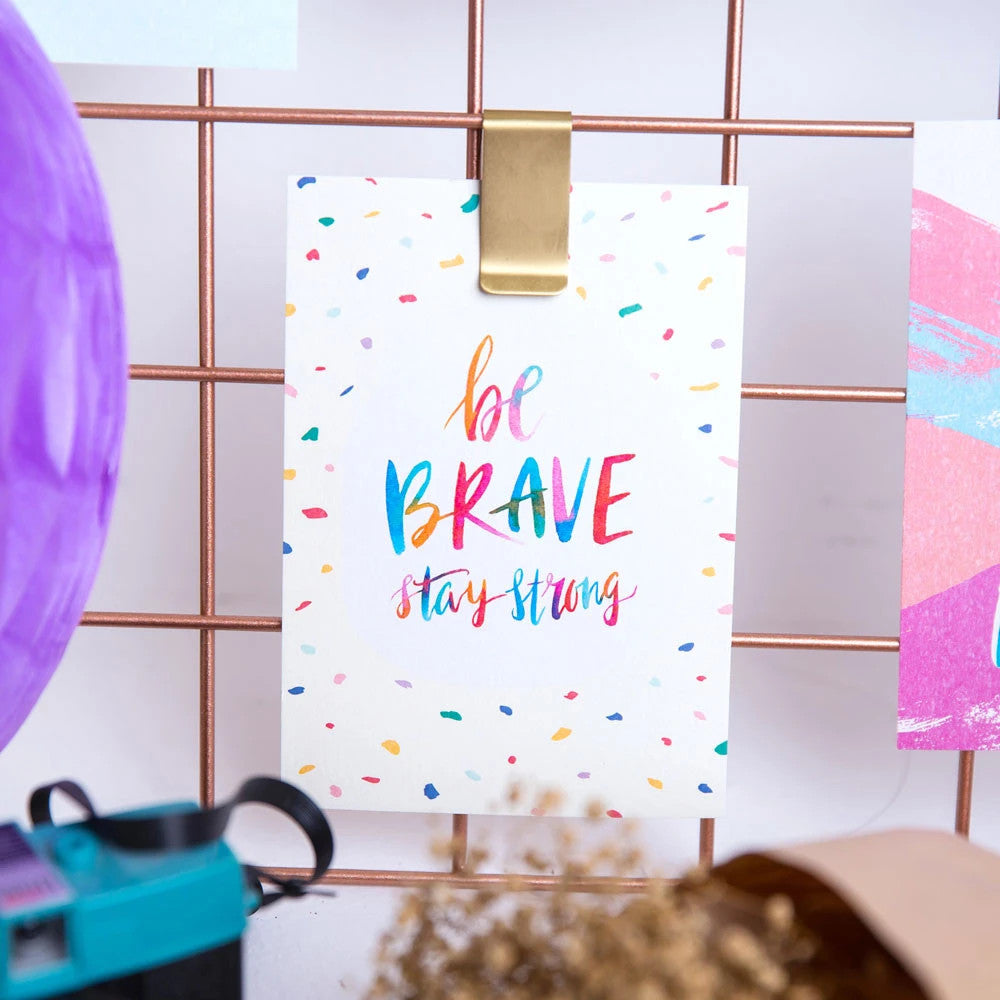 be brave stay strong greeting card pinned on a moodboard.