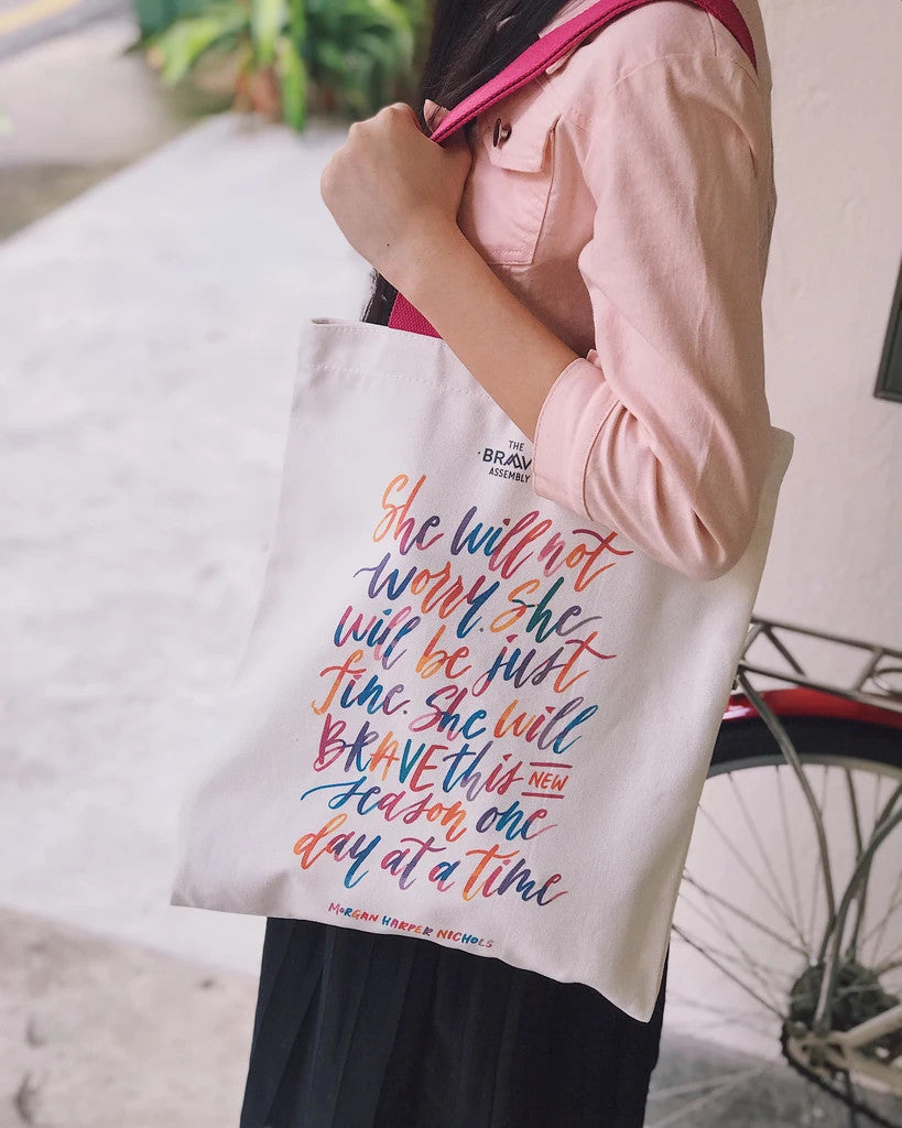 Encourage tote bags to empower women. The totebag has colourful typography of women quotes