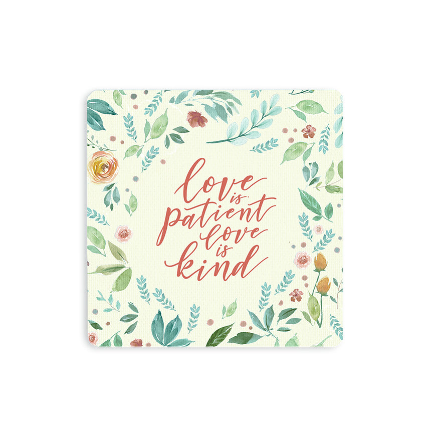 "10cmx10cm cream wooden coaster with floral designs and encouragement bible verse "" Love is patient, love is kind""."