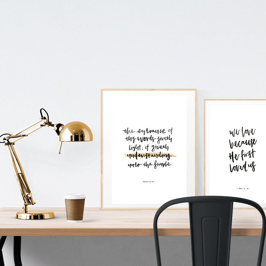 A3 calligraphy poster placed standing next to a smaller A4 sized calligraphy poster with on a wooden table. Inspiring home decor ideas.
