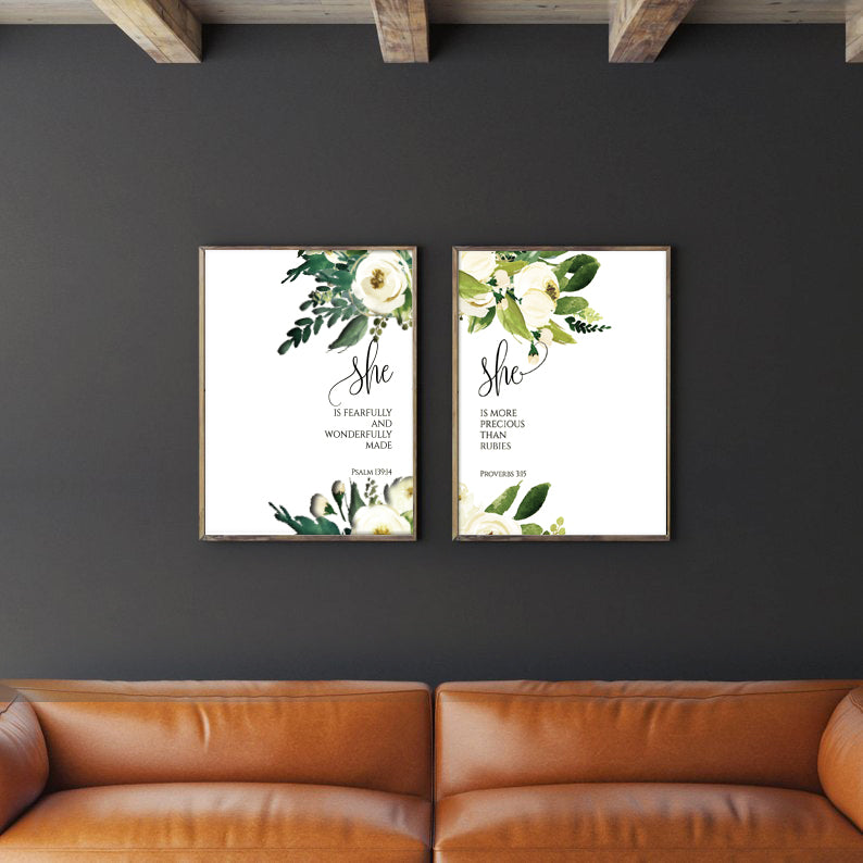 2 A3 paintings placed next to each other on a black wall. Rustic and minimalistic living room decor ideas.