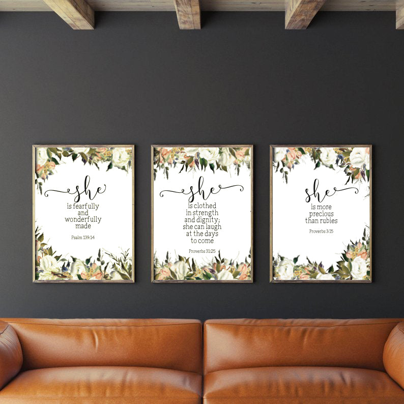 3 A3 posters hung on a blqck wall, rustic living room decor ideas