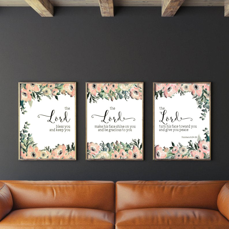 3 A3 posters hung on a black wall, rustic living room decor ideas