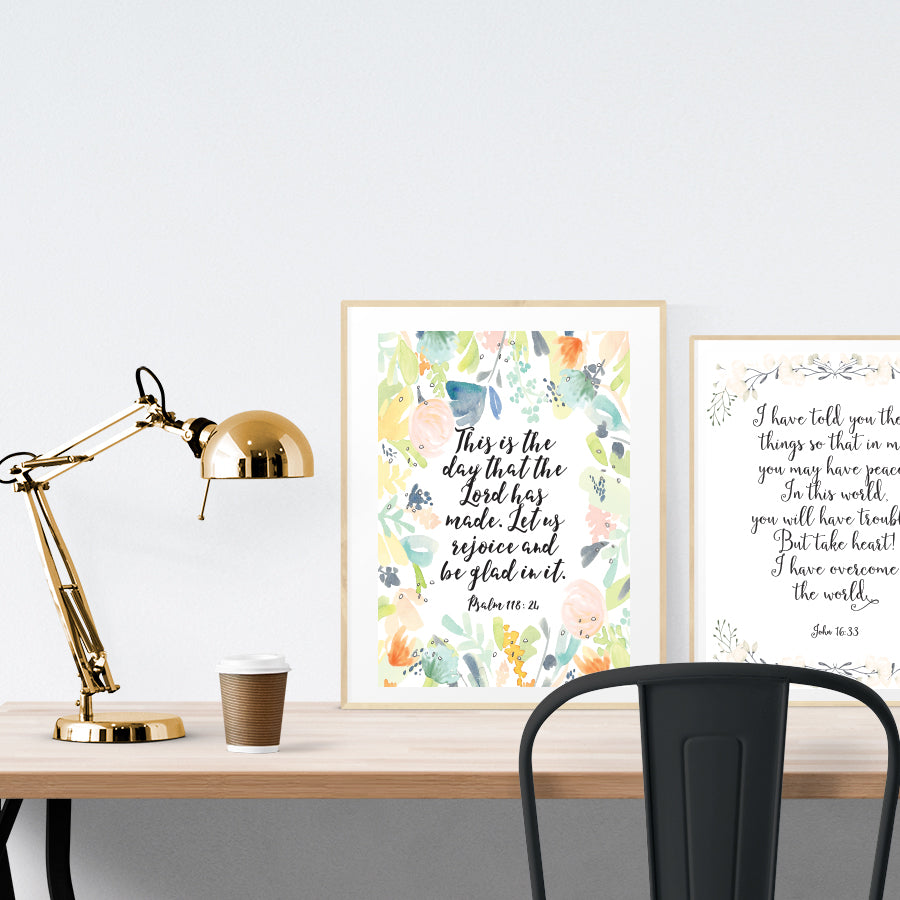 A3 beautiful calligraphy poster placed standing next to a smaller A4 sized calligraphy poster on a wooden table. Pretty home interior design ideas.