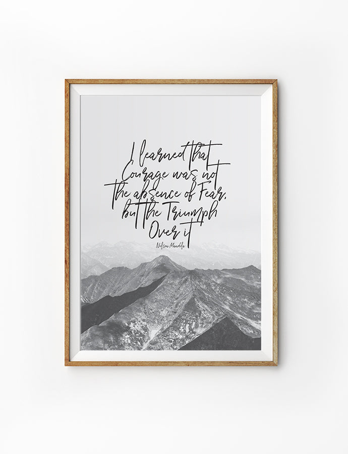 Calligraphy courage themed poster. Courage was not the absent of fear, but the triumph over it. Nelson Mandela quotes. Stay strong and courageous. Mountains background.