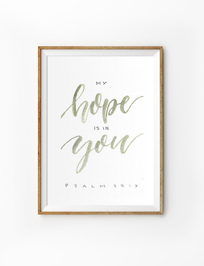 Poster featuring beautiful typography bible verses with colourful font designs 'my hope is in you' is hung on the wall in a gold photo frame'. 200GSM paper, available in A3,A4 size.