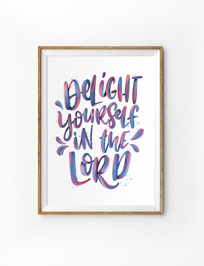 Poster featuring typography bible verses 'Delight yourself in the Lord'  is hung on the wall in a gold photo frame. 200GSM paper, available in A3,A4 size.